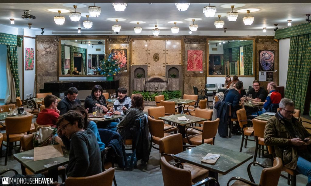 Patrons in the Art-Deco café Lucerna in Prague