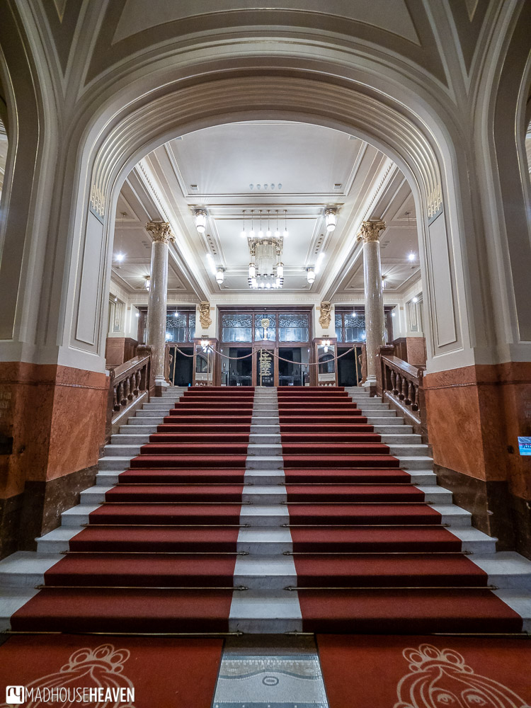 Grand marble staircase leading up towards the concert halls of the Obecni Dum