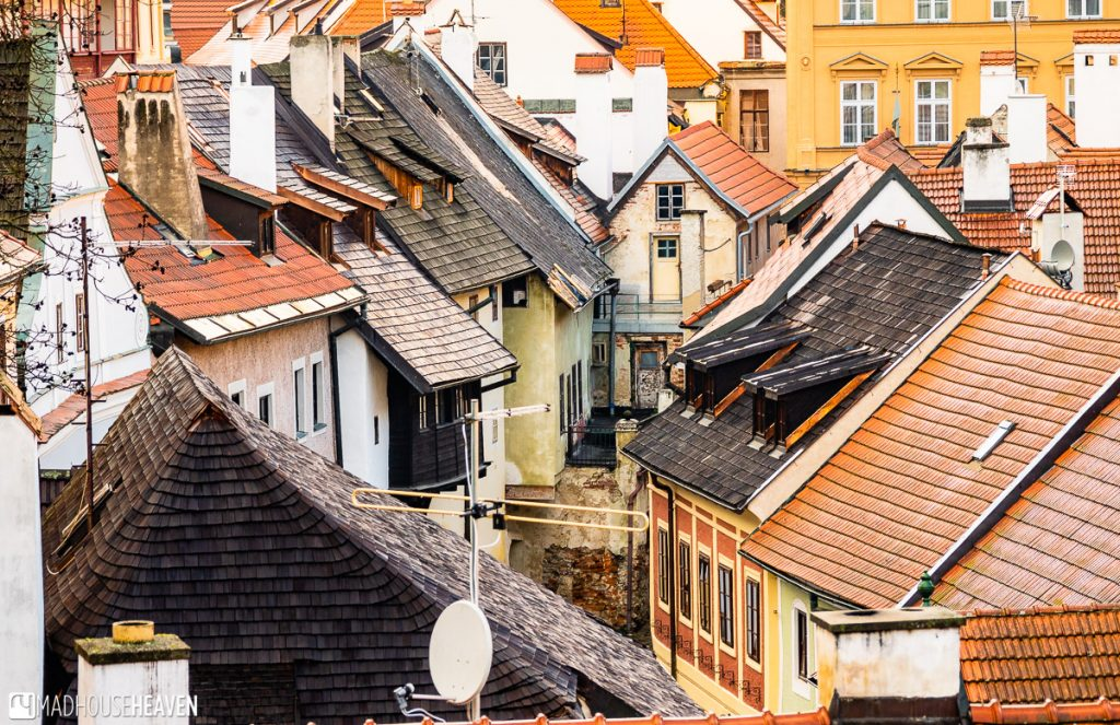 Incredibly cute medieval houses in Cesky Krumlov's old town. These houses line a curving street.