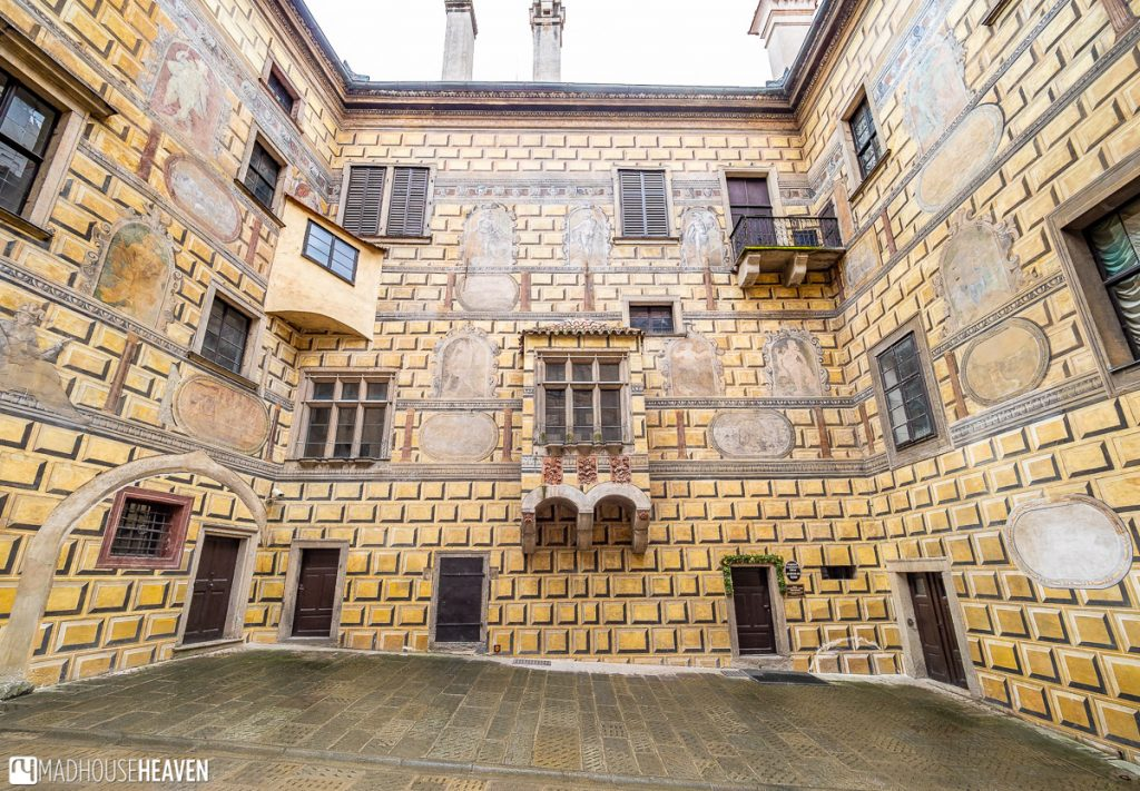 Decorative Renaissance courtyard with Gothic windows and Italian sgrafitto murals