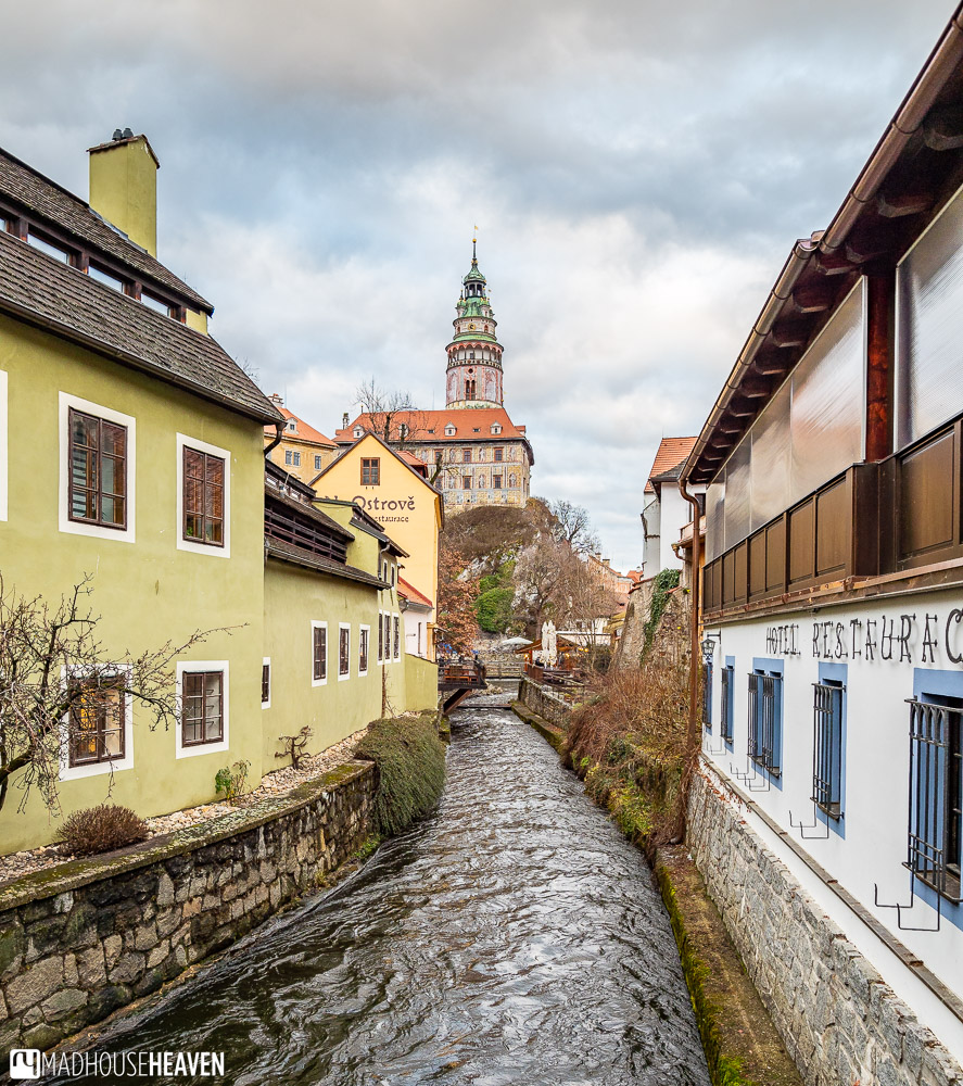A narrow stretch of the river Vlatava, running towards the Cesky Krumlov castle
