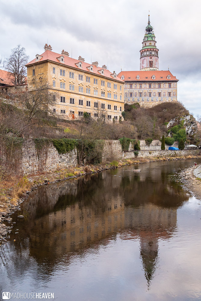 The Cesky Krumlov castle and tower reflected in the still waters of the Vlatava river just before dusk in Cesky Krumlov