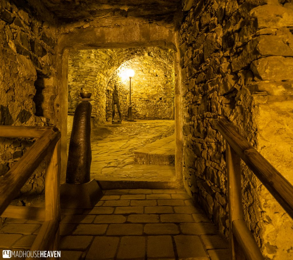 Wooden handrails guide visitors around the stone labyrinth in the castle cellars of the Krumlov castle