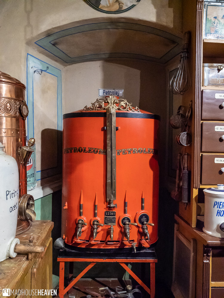 A large metal tank on example in the museum of commerce from the 1900s that dispensed petroleum
