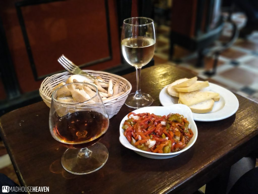 Spanish tapas - sweet roasted peppers, local cheese, white wine and cognac