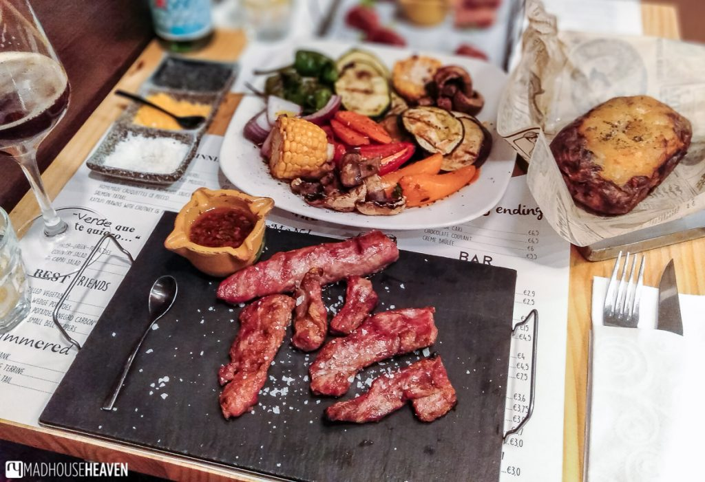 A table laid out with food from the grill