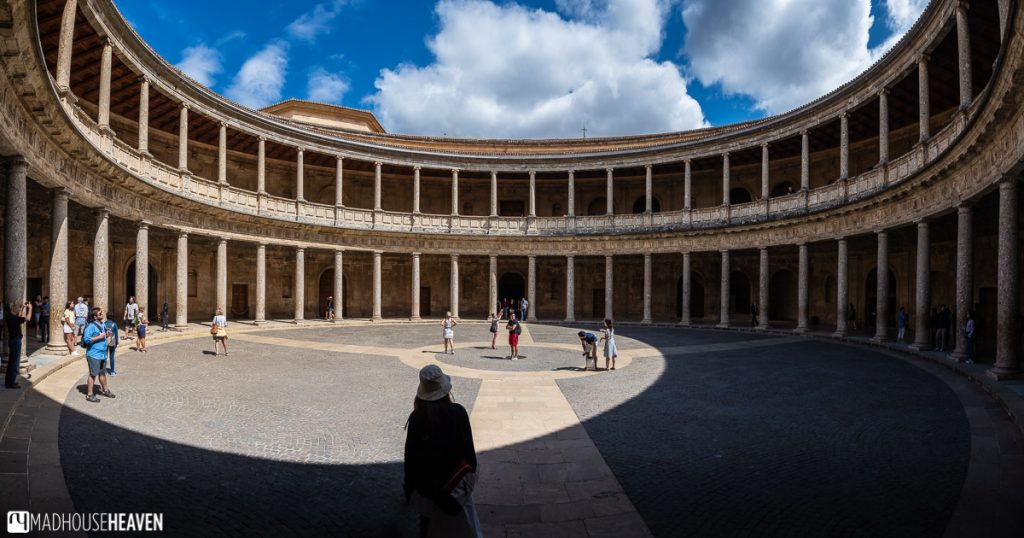 The circular interior of the Palacio de Carlos V in Alhambra with its many columns