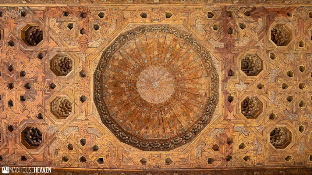 The elaborate wooden ceiling of the Tower of the Ladies decorated with geometric designs