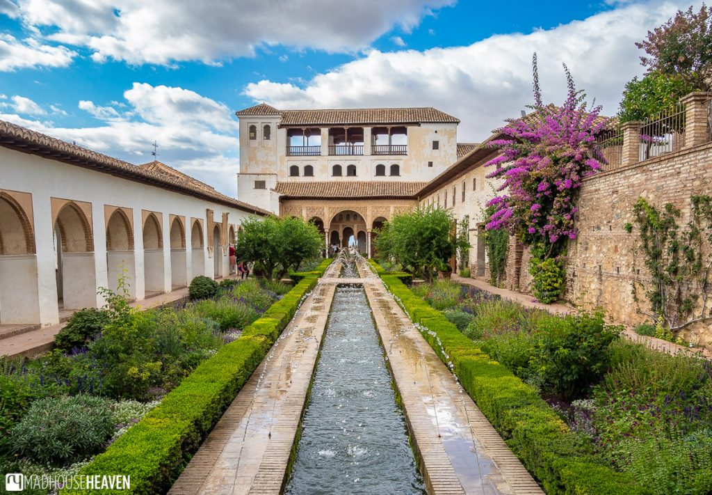 A long rectangular fountain running the entire length of the Patio de Acequia in Generalife, Alhambra
