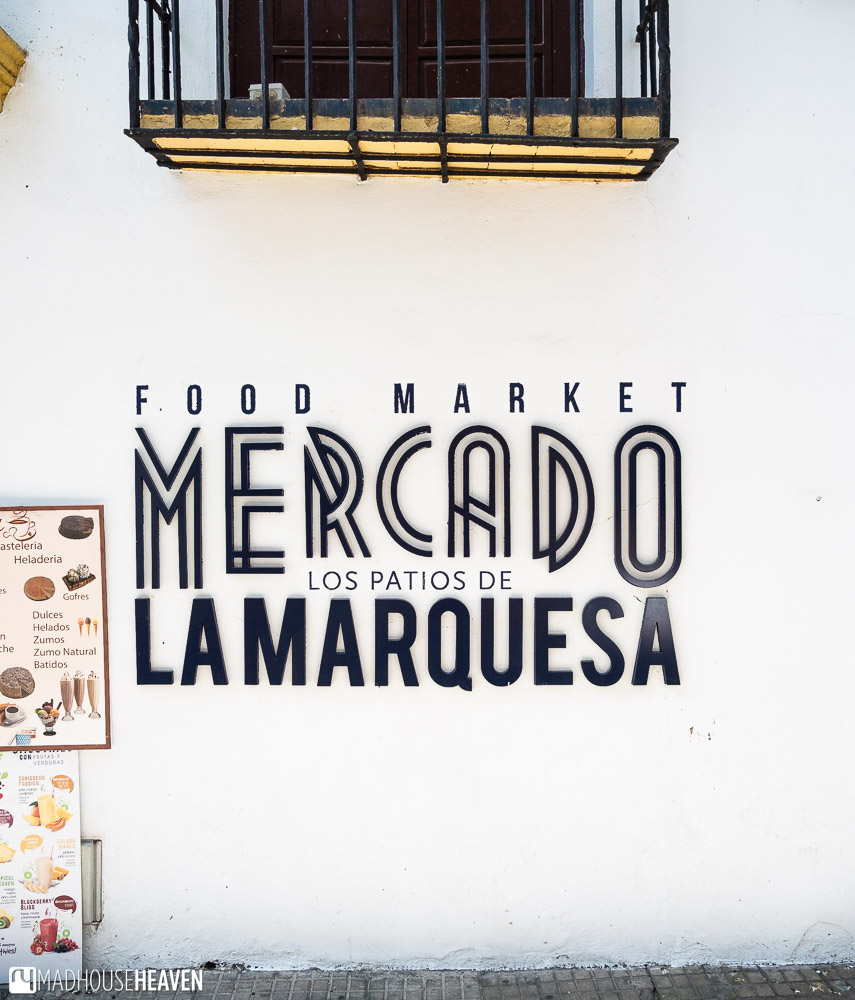 Graphic typography on the wall spelling out the name of the Mercado Los Patios de la Marquesa