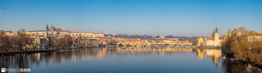 The perfect shot of the Charles' bridge lit by the light of the fiery sun