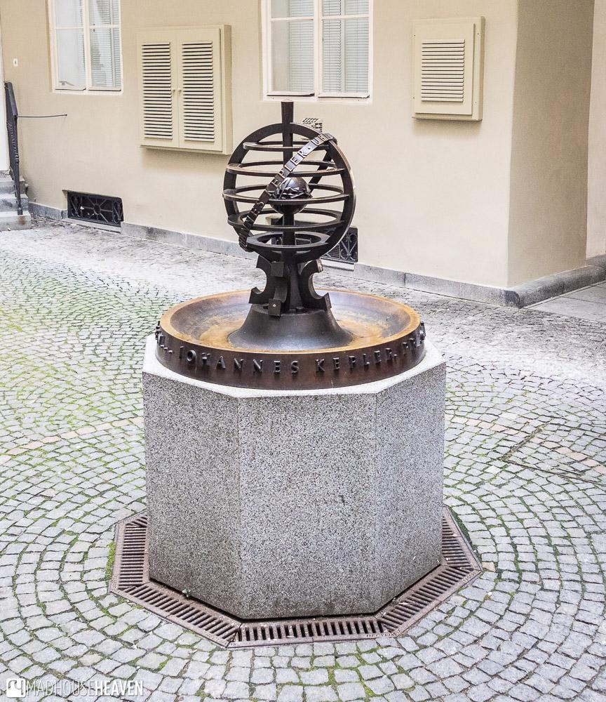 A small bronze statue of modern design commemorating the work of Johannes Kepler, in Prague