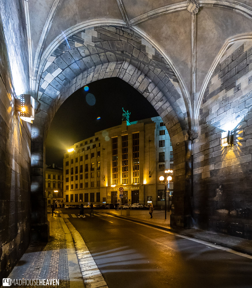 a road passing under the high vaulted ceilings of Prague's gothic powder tower