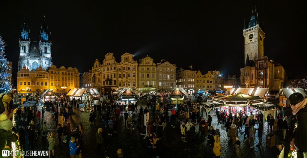The Prague Market square at Christmas, filled with people