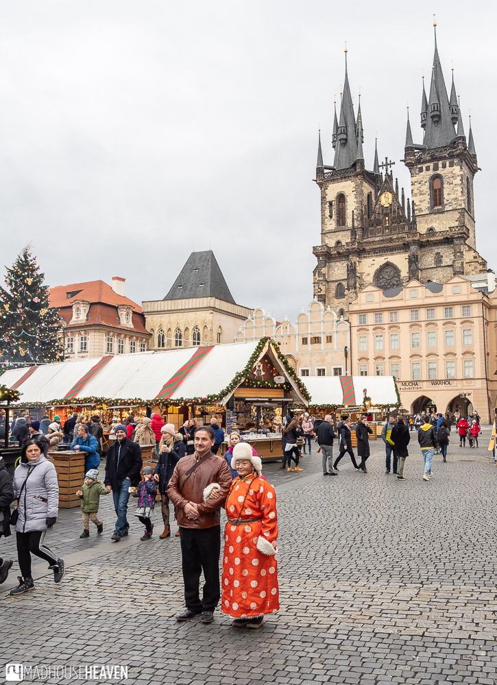 A Mongolian woman in a winter kimono in the old town square of Prague
