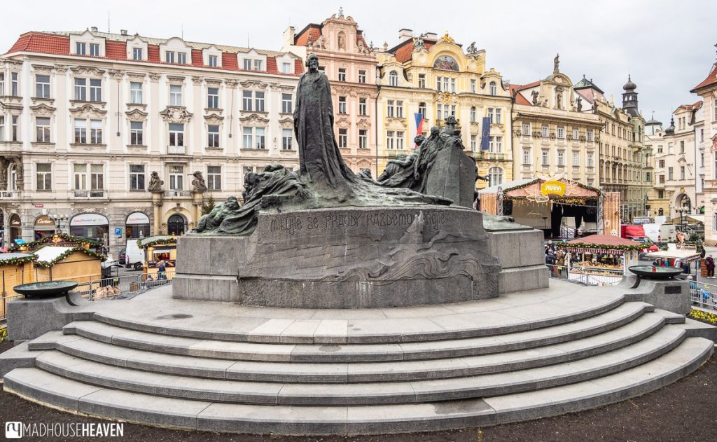 The imposing Jan Hus monument in Prague's old town market square is surrounded by colourful secessionist buildings