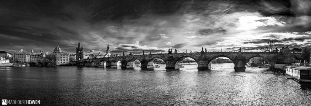 Panorama of Charles Bridge curving across the Vlatava river