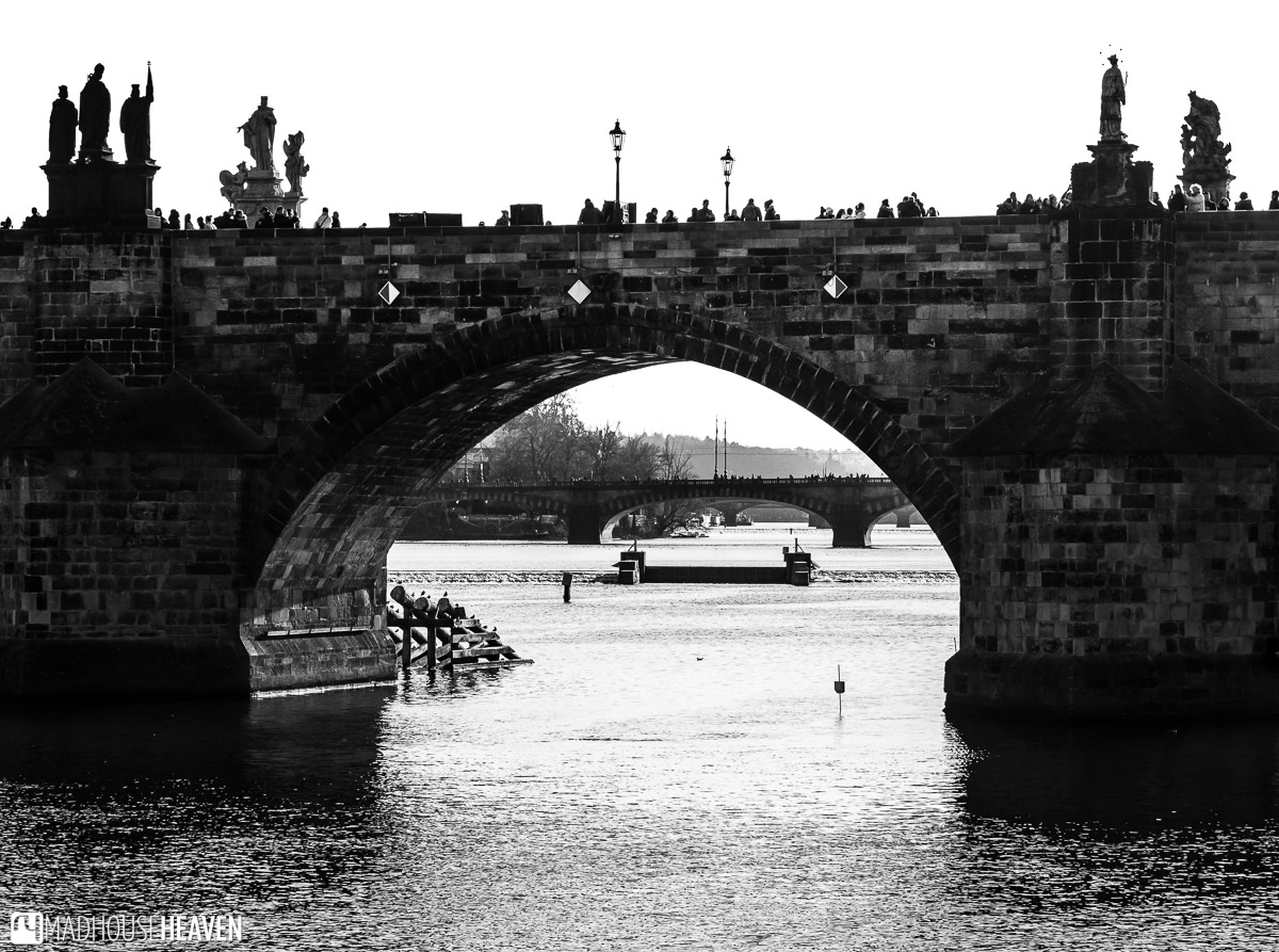 Black and white image of Charles Bridge, over the Vltava River, in Prague