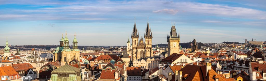 A panorama of Prague on a sunny winter's day with the towers of the Klementinum, the piercing spires of the Church of our Lady before Týn and the Old Clock Tower