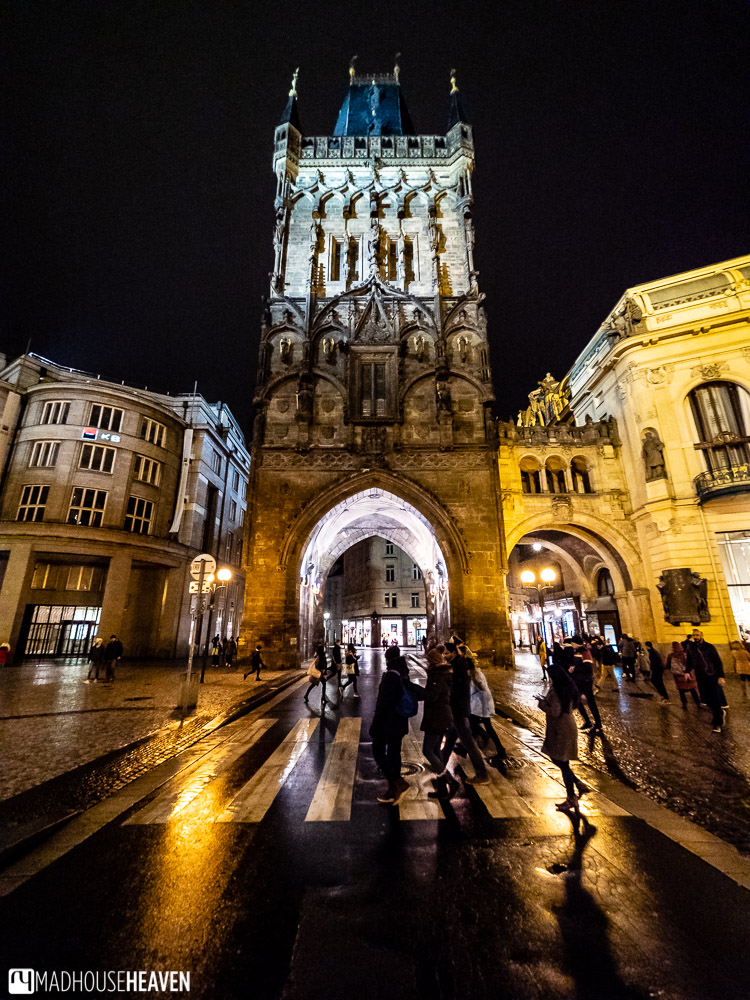 A dramatically lit Gothic tower at the entrance to Prague's Old Town