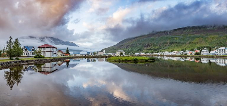 Dusk over the sleepy Icelandic town of Seydisfjordur, reflected in the lake