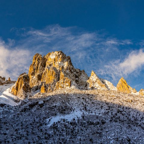 Snow Covered Mount Kenya Peaks Against Blue Sky