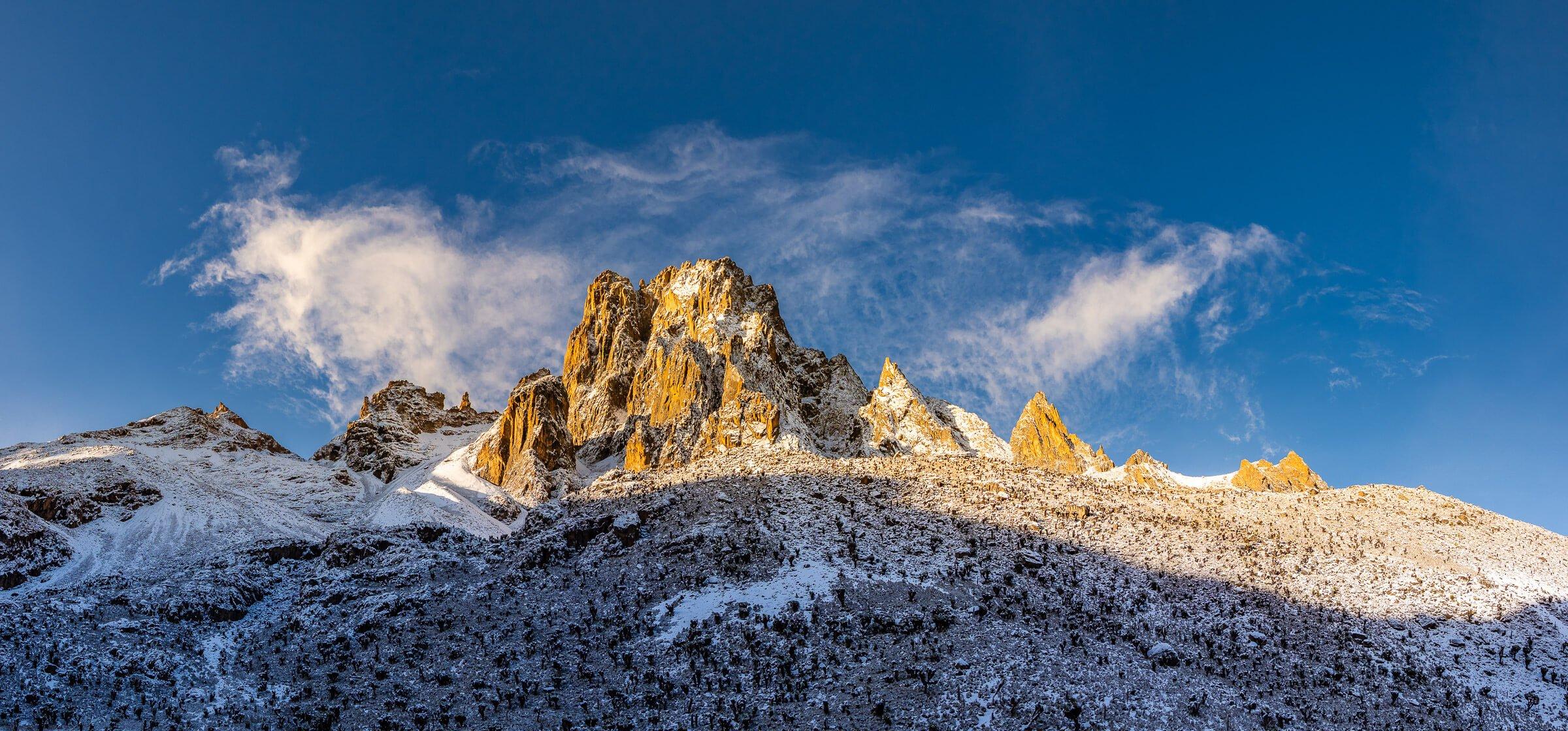 Snow Covered Mount Kenya Peaks Against Blue Sky