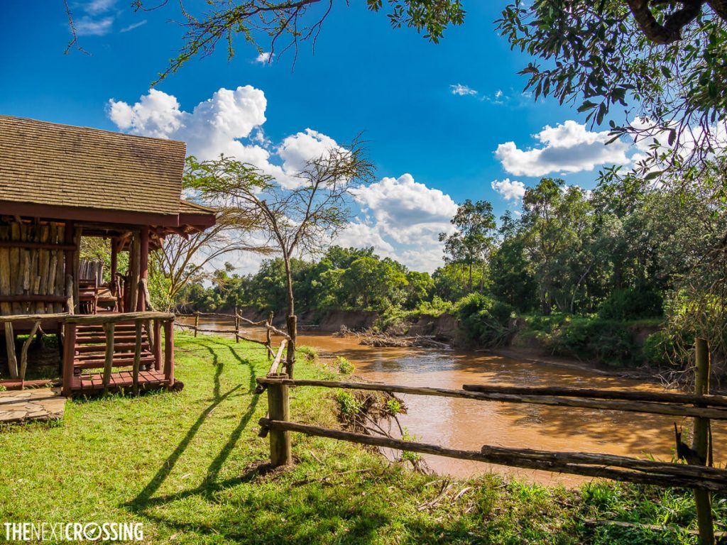 Royal Mara Safari Lodge wooden deck with tented camp beside the Mara River