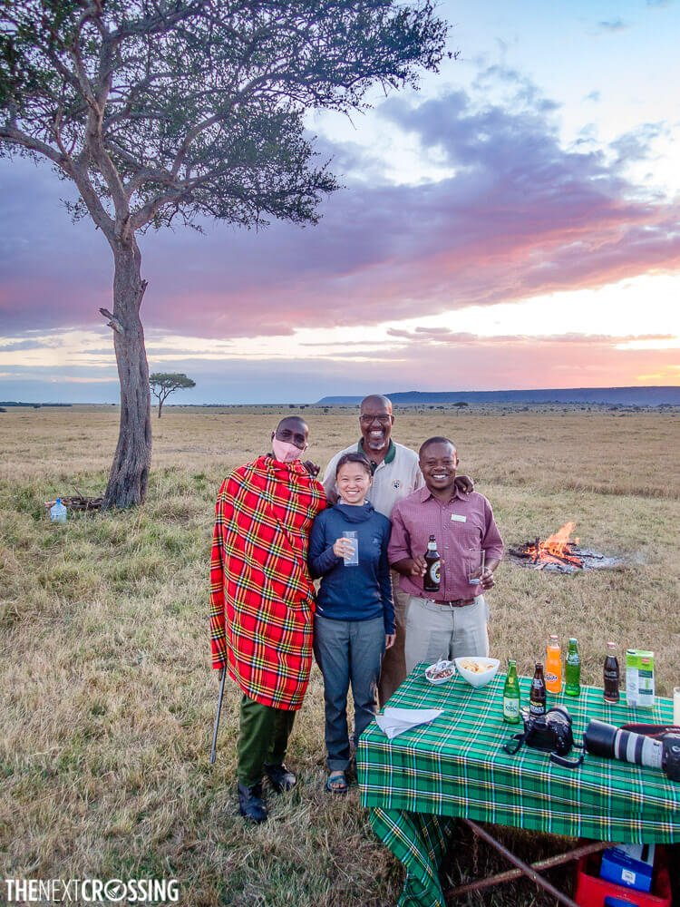 Maasai ascari wrapped up in shuka because the weather on the Masai Mara is cold in the evening