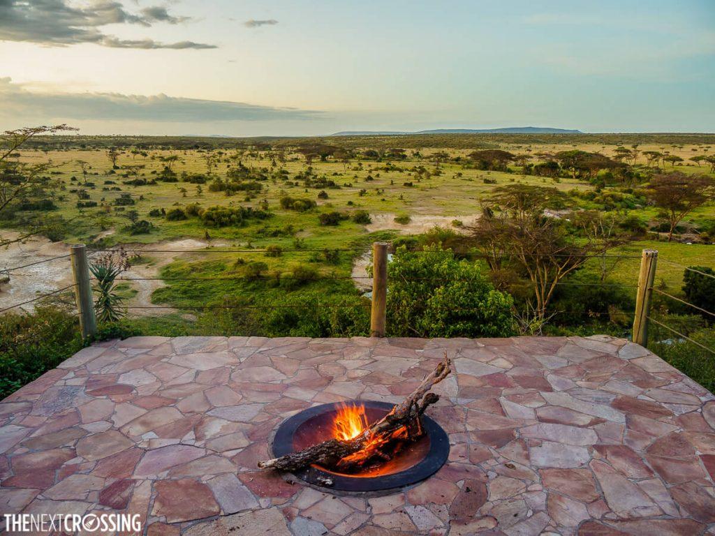 Campfire at sunset over the masai mara at eagle view
