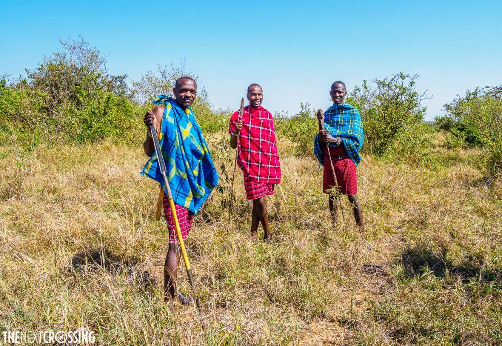 Three Maasai guides standing in the bush of the Mara Naboisho plains