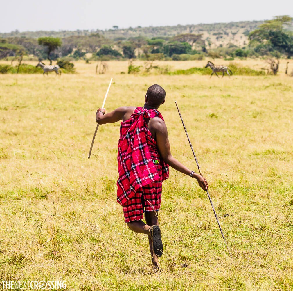 Maasai man demonstrating how to throw a spear