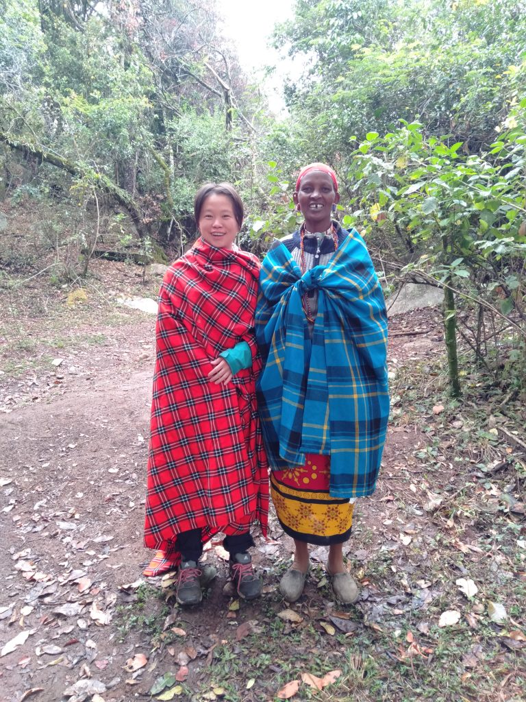 Asian girl with Maasai woman in Loita hills along the banks of the entasopia