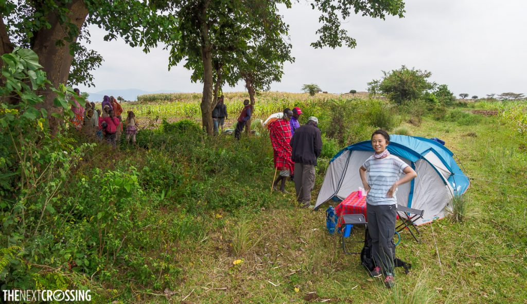 campsite in the maasai village of narosura with maasai children looking on