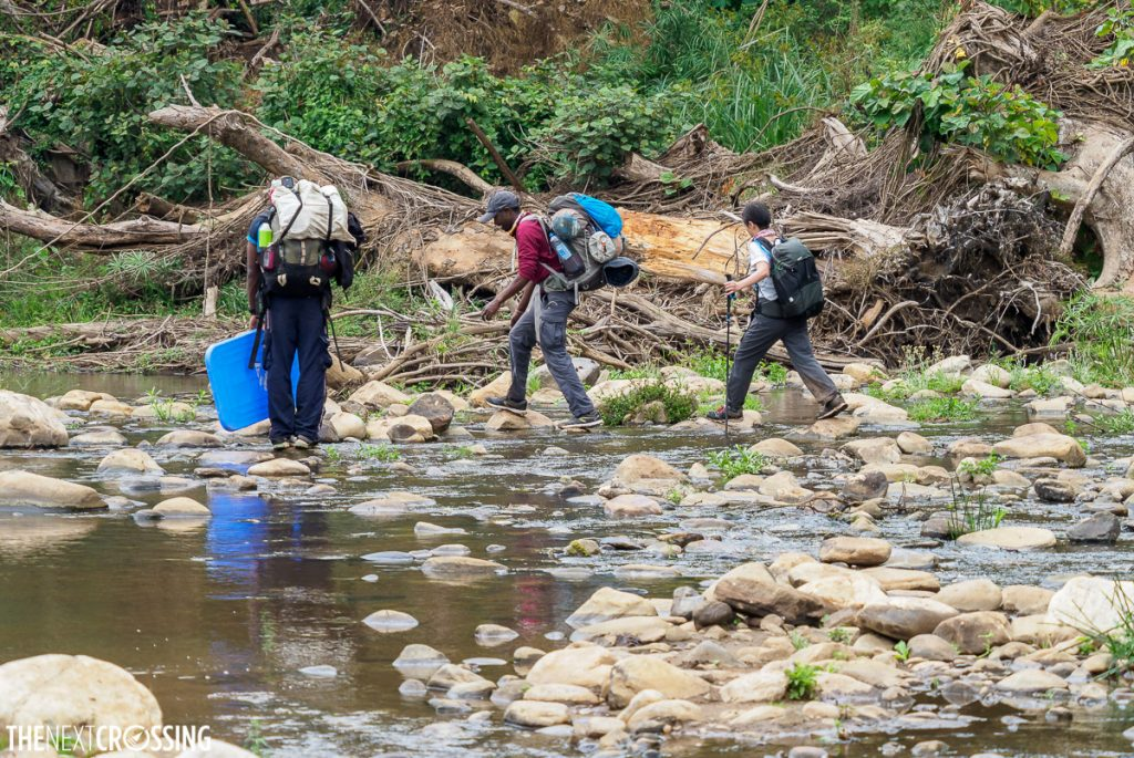 Crossing a river in loita hills with our maasai guides