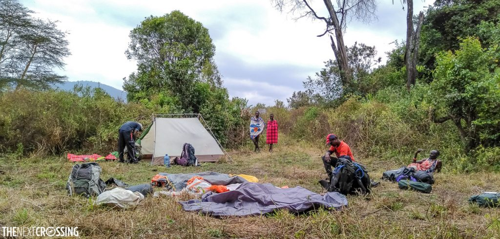campsite in a maasai village surrounded by dense bush