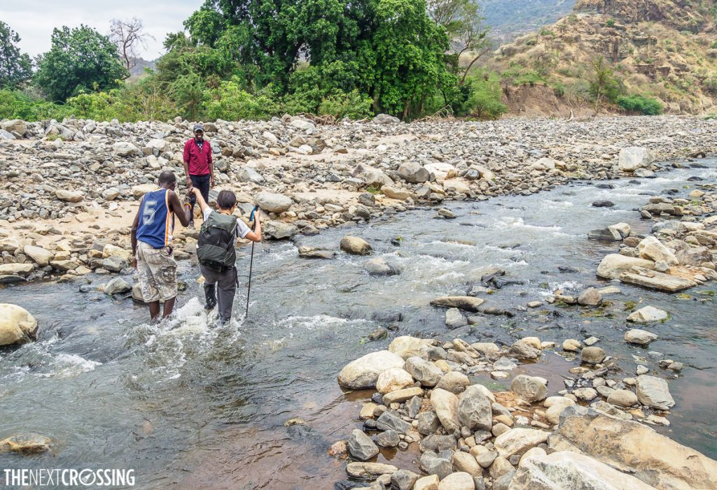 Wading through the Lenkutoto river in Maasai land in Loita Hills