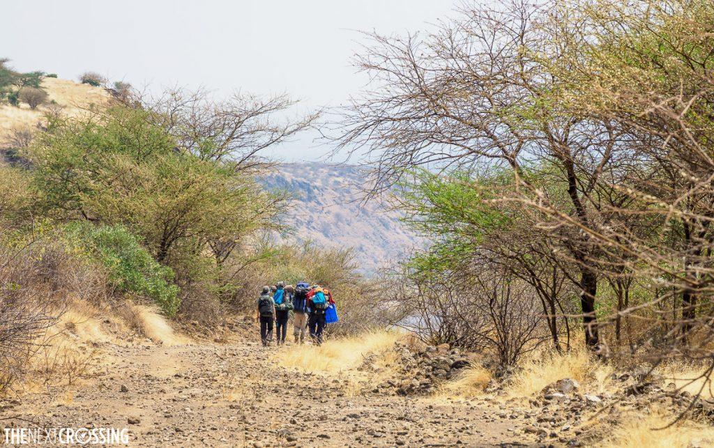 Kikuyu kenyan guides hiking in the magadi lake area