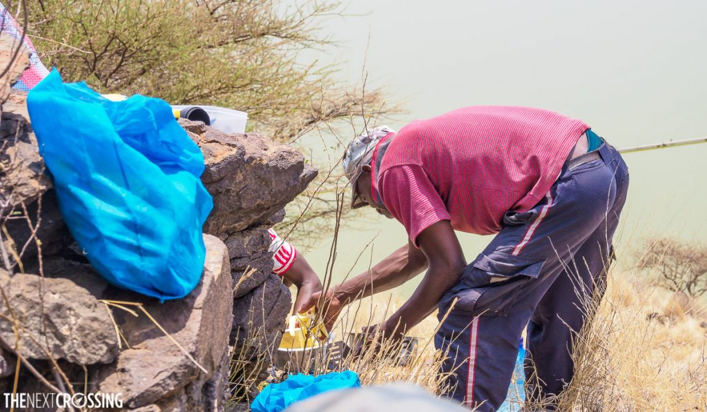 kenyan guides cooking on the edge of the world