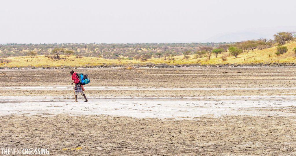 Johnny, our maasai guide crossing the salt flat of magadi lake